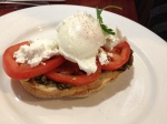 Organic Toast with Pesto, Tomato, Goat's Cheese and a Poached Egg