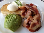 Poached eggs with bacon and avocado
